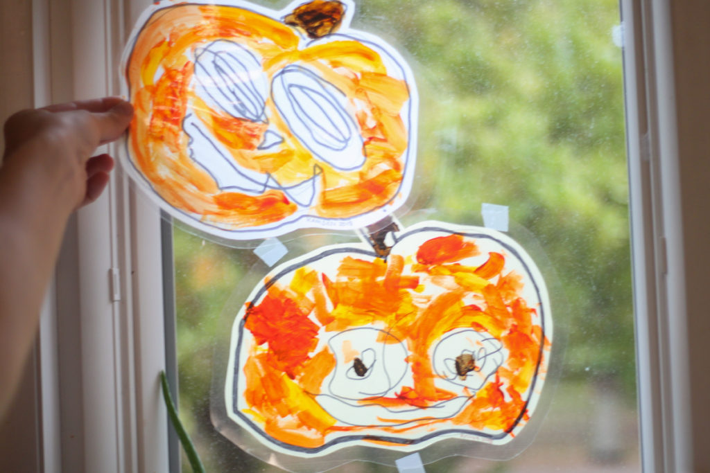 Fall Pumpkins Halloween Craft for Kids -  Jack o lantern window catcher painting project perfect for toddlers preK or kindergarten kids - Midkid Mama Blog